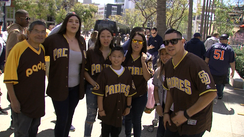 Padres fans celebrating the 2019 season opening game at a block party in San ...
