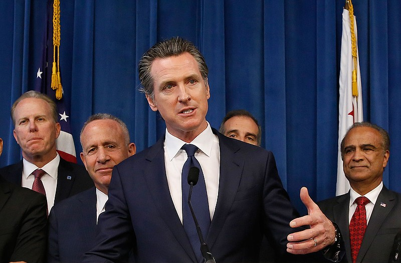 Gov. Gavin Newsom, center, discusses the homeless problem facing California a...