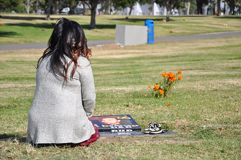 Bevelynn Bravo visits the grave of her son on November 15, 2018.