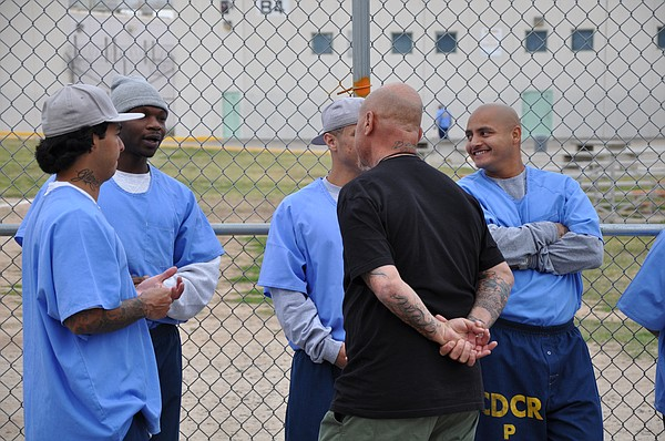 Dennis Martinez speaks with inmates at Centinela State Pr...