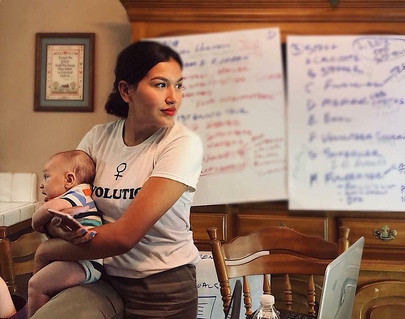 Jewel Hurtado with her son at her kitchen table headquarters in her grandmoth...
