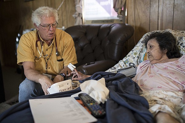 Nurse Practitioner Chris Ruge during a home visit with a ...