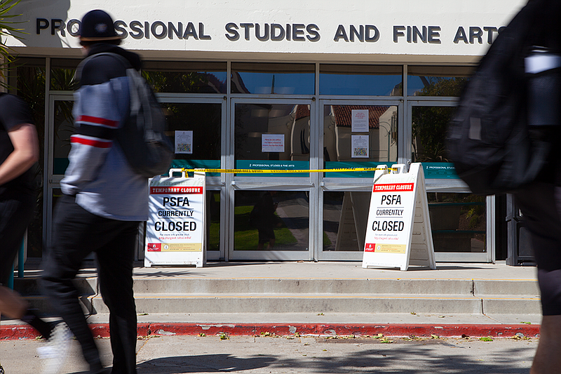 Students pass the College of Professional Studies and Fine Arts building at S...