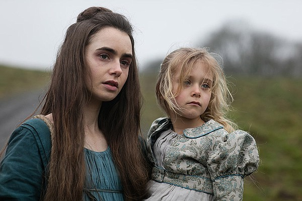 Fantine (LILY COLLINS) and Cosette (MAILOW DEFOY)