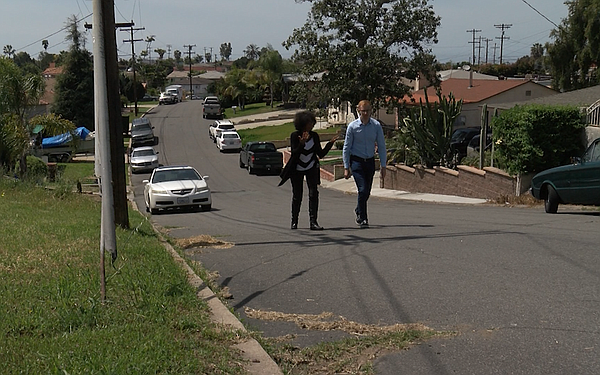City Councilwoman Monica Montgomery walks with KPBS repor...