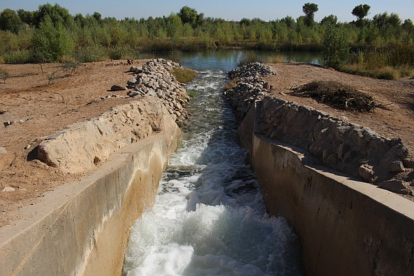 Colorado River water, carried by an irrigation canal, spi...