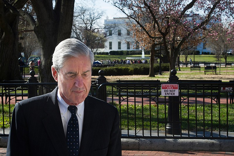 Special Counsel Robert Mueller walks past the White House after attending ser...