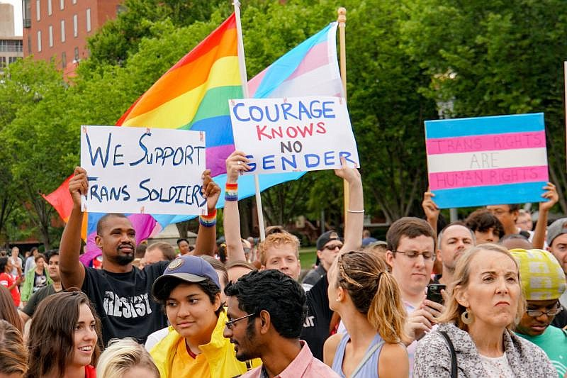 Protesters opposed to the Trump Administration's military transgender ban mar...