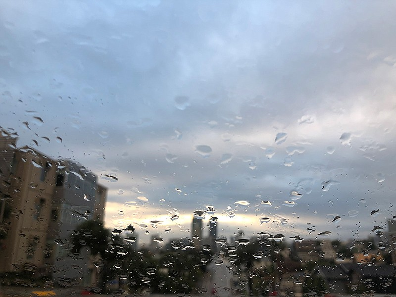 Downtown San Diego is seen from Grant Hill through a rainy windshield, Jan. 1...