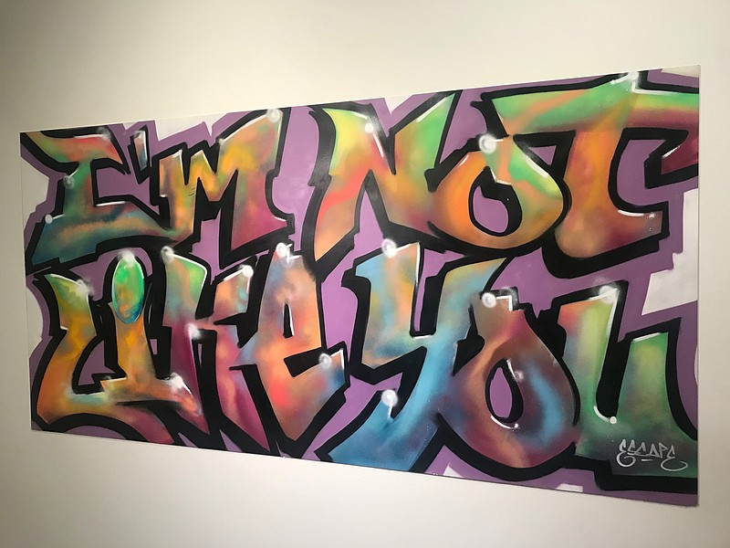 Graffiti art by ESCAPE hanging the San Diego History Center's exhibition