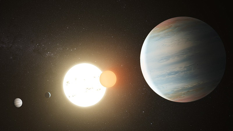 Artist's rendition of the Kepler-47 circumbinary planet system with its three...