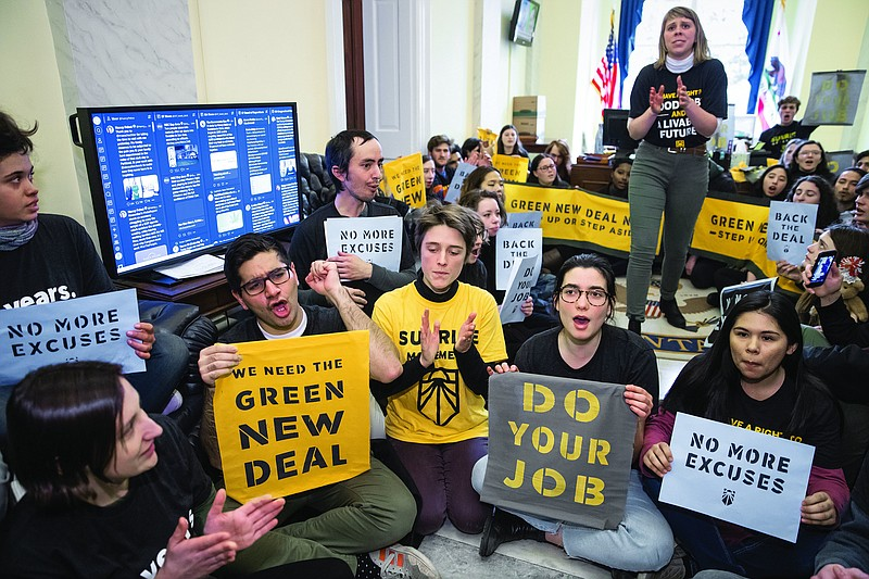 Environmental activists occupy the office of House Democratic Leader Nancy Pe...