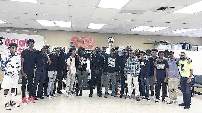 Students from Hoover High School pose for a picture after a