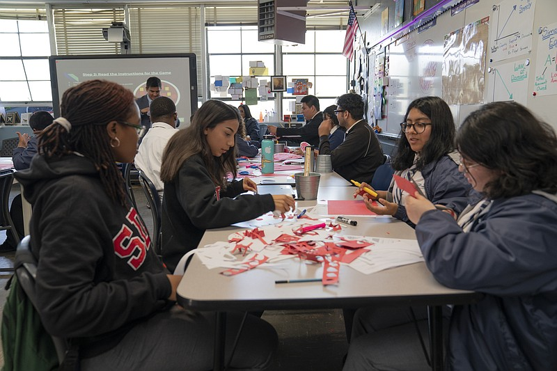 Students at Gompers Preparatory Academy in San Diego work on a class project....