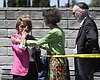 Synagogue members console one another outside o...