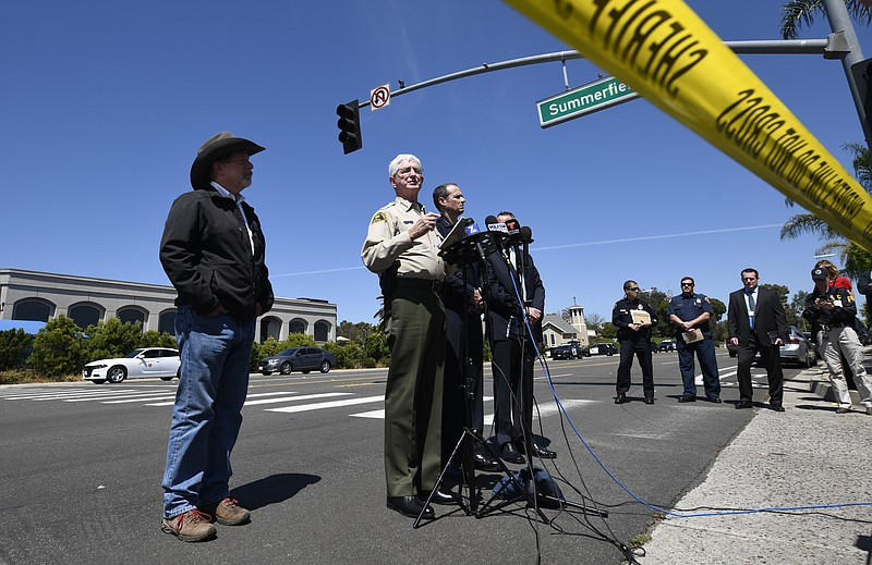 San Diego County Sheriff Bill Gore, center, speaks at a news conference held ...