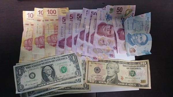 U.S. and Mexican money seized at a crime scene in Tijuana...