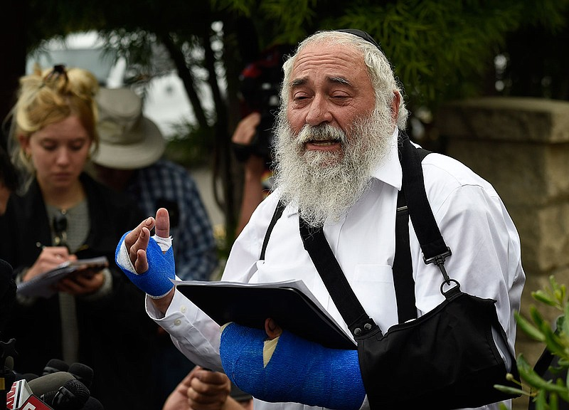 Rabbi Yisroel Goldstein speaks at a news conference at the Chabad of Poway sy...