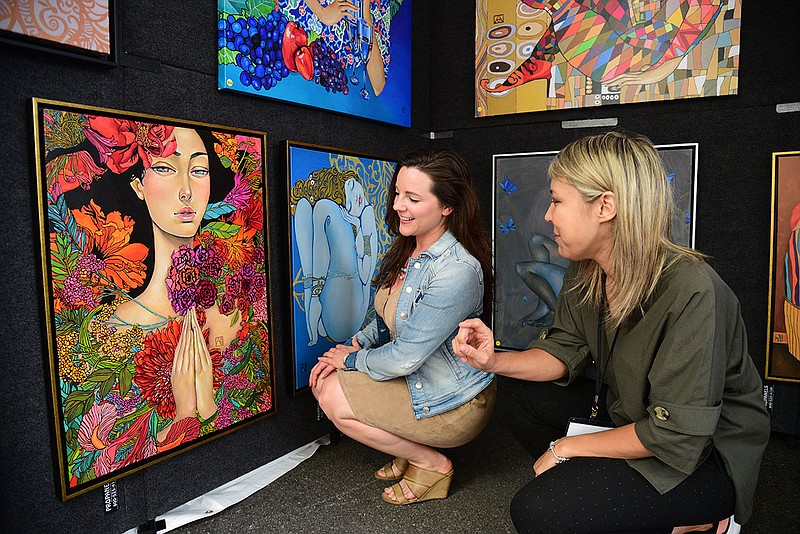 A 2018 photo of artist Akzhana Abdileva (right) at Mission Federal ArtWalk.