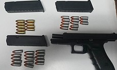 A 9mm handgun seized by Mexican authorities is ...