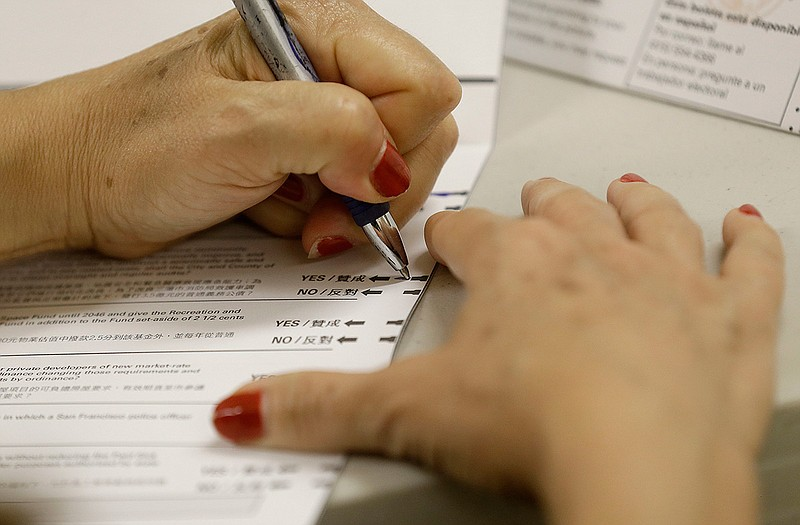 A woman fills out a ballot in California, June 7, 2016.