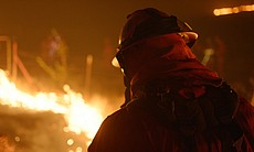 Firefighter at night. (undated photo)