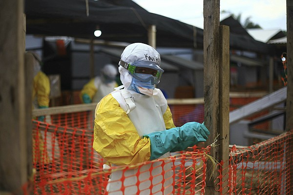 An Ebola health worker is seen at a treatment center in B...