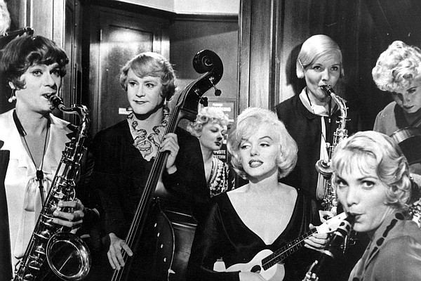 Tony Curtis and Jack Lemmon play musicians who have to dr...