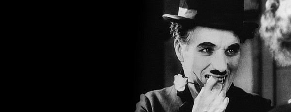 Charlie Chaplin as his iconic Little Tramp in