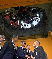 President John F. Kennedy (with sunglasses) is briefed by NASA officials at the Saturn rocket at Pad B, Complex 37, Cape Canaveral, Fla. Nov. 16, 1963.