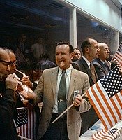 A group of NASA and Manned Spacecraft Center (MSC) officials join with the flight controllers to celebrate the successful conclusion of Apollo 11. July 24, 1969.