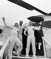 The Apollo 8 crew stands in the doorway of a recovery helicopter after arriving aboard the carrier USS Yorktown, prime recovery ship for the historic Apollo 8 lunar orbit mission. Left to right, are astronauts Frank Borman, James A. Lovell Jr., and William A. Anders. Dec. 27, 1968.