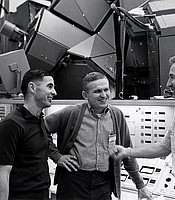 Apollo 8 crew members paused before the mission simulator during training for the first manned lunar orbit mission. Frank Borman, Commander (center); James Lovell, Command Module Pilot (right); and William Anders, Lunar Module Pilot (left). Dec. 17, 1968.