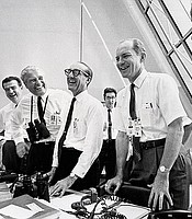 NASA officials (left to right) Charles W. Mathews; Dr. Wernher von Braun, Director, Marshall Space Flight Center; Dr. George E. Mueller, Associate Administrator for Manned Space Flight; and Air Force Lt. General Samuel C. Phillips, Apollo Program Director celebrate the successful launch of Apollo 11 in the control room at the Kennedy Space Center. July 16, 1969.