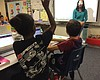 Jada Gill, 10, raises her hand to ask fifth-gra...