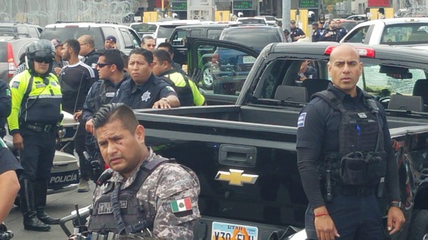 Mexican law-enforcement officials and first-responders at...