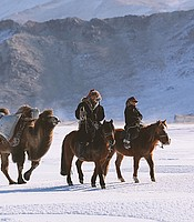 Auez and his son Janibek, starting the winter migration, Altai Mountains.