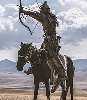 Mongol warrior on horseback with whistling arrow.