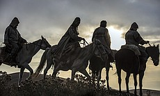 Yamnaya men and women on horseback, sunset.