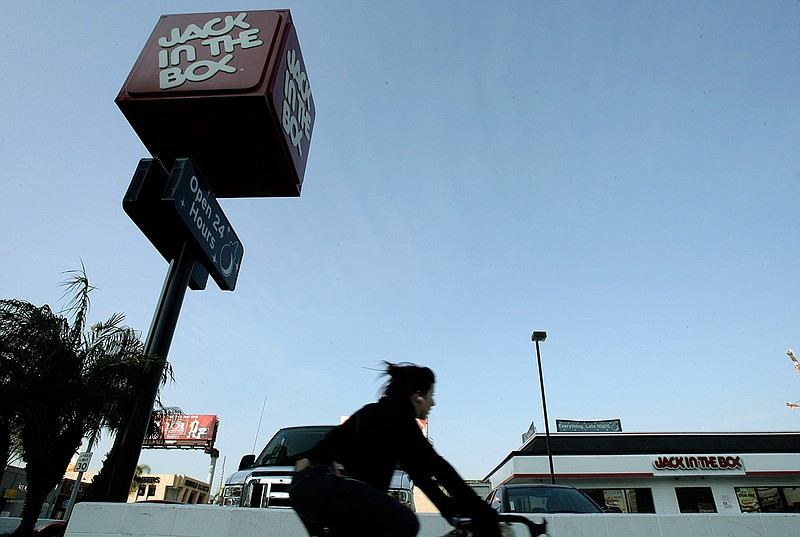 A bicyclist rides pass a Jack-In-the-Box Sunday, Feb. 17, 2008, in Los Angeles