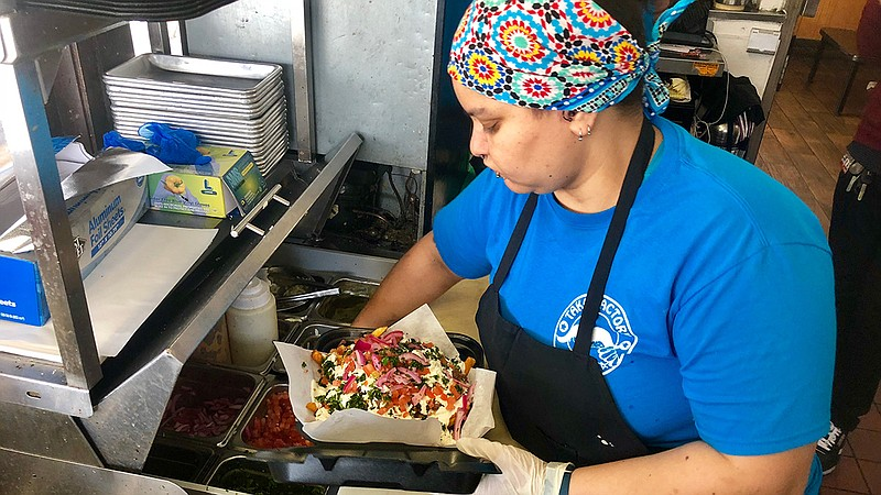 Carne asada fries are made by a worker at Tako Factory off El Cajon Blvd. in ...