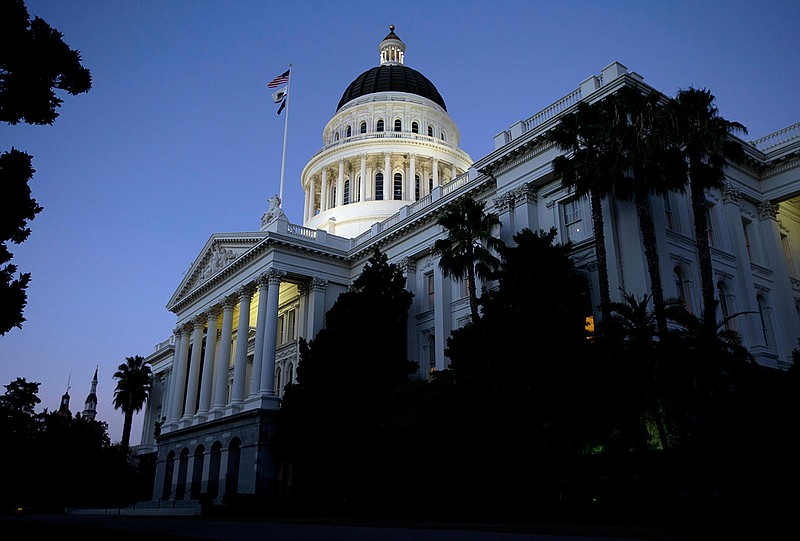 The California State Capitol in the early evening in Sacramento, Wednesday, A...