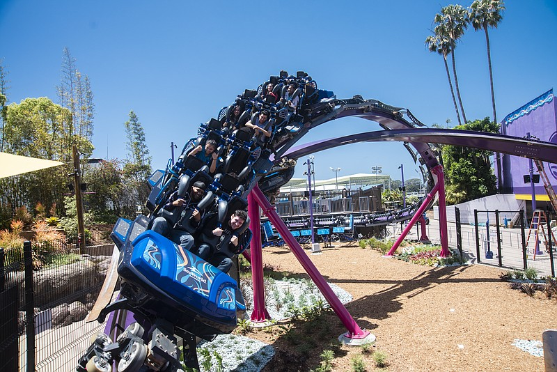 "Park guests ride SeaWorld's newest roller coaster, the ""Tidal Twister"", in th..."