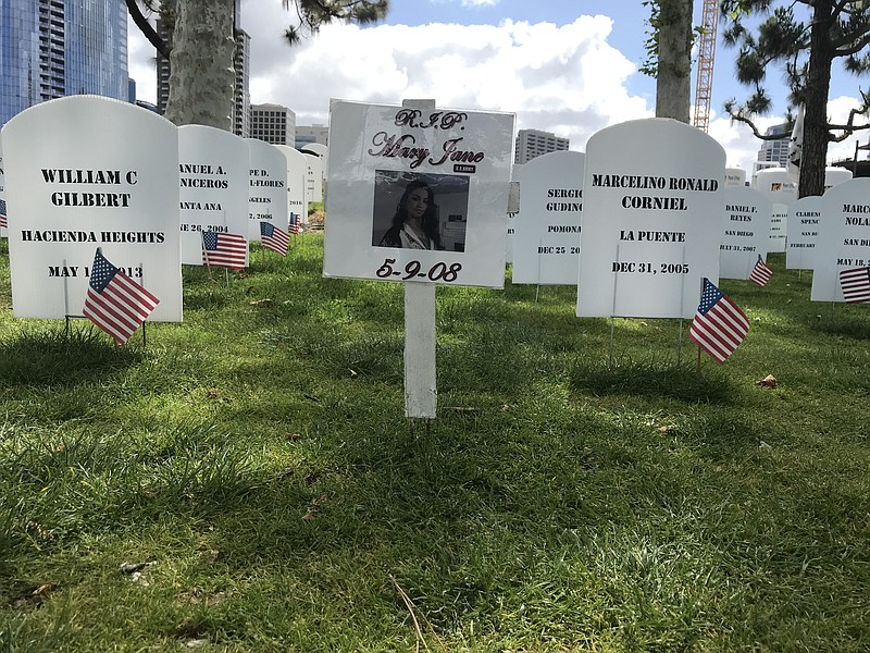 Mock headstones at a memorial by Veterans for Peace outside the USS Midway to...
