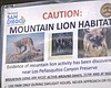 A sign warning parkgoers of mountain lion activ...