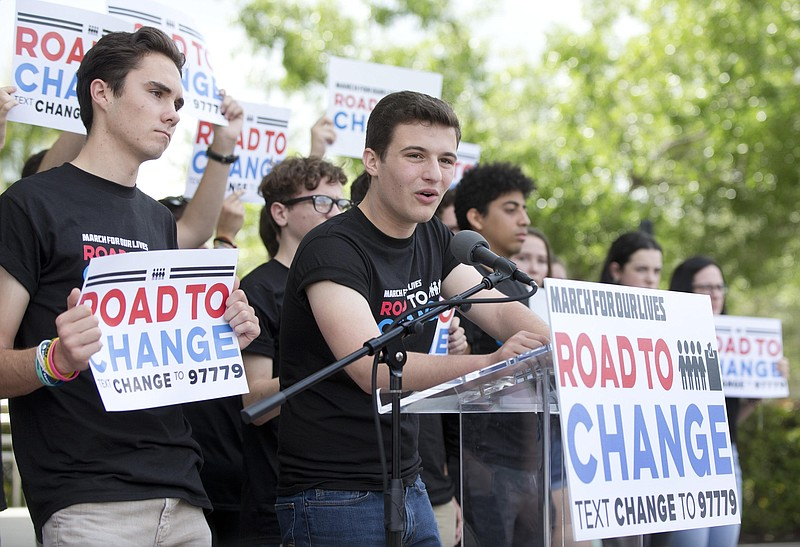 Parkland shooting survivor Brendan Duff stands behind a lectern at a March fo...
