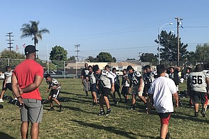 Photo for Former Chargers Player Leads City Heights Football Team To National Victory