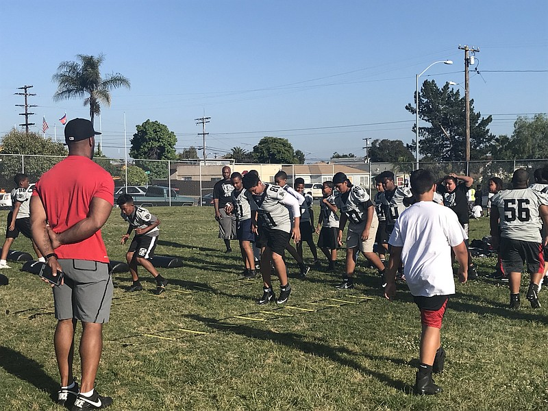 Coach Stephen Cooper, a former San Diego Chargers player, leads the Balboa Ra...