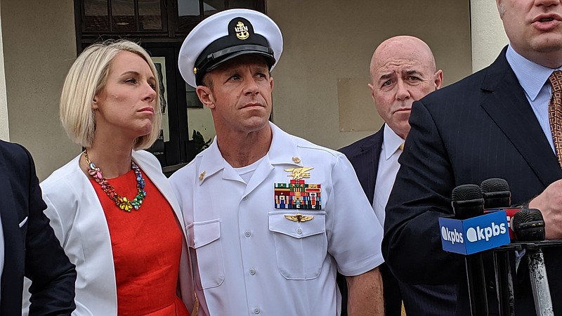 Andrea Gallagher with her husband Navy SEAL Edward Gallagher during a press c...