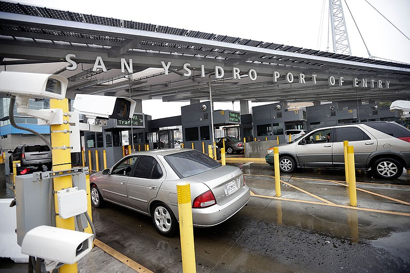 Cars wait to enter the United States from Tijuana through the San Ysidro Port...